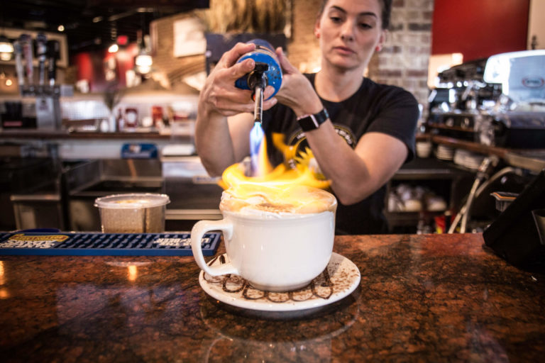 bartender making drink with blowtorch