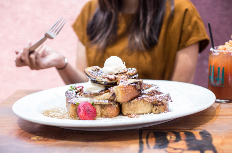 woman eating french toast